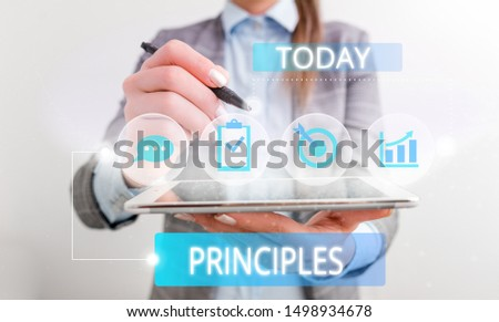 Conceptual hand writing showing Principles. Business photo text fundamental truth that serves as the base for a system of belief Female human wear formal work suit presenting smart device. Сток-фото ©