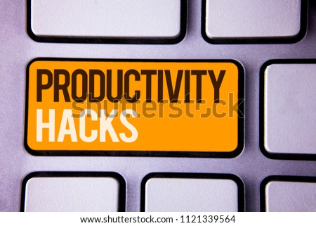 Conceptual hand writing showing Productivity Hacks. Business photo text Hacking Solution Method Tips Efficiency Productivity Gray color polished keyboard with yellow button black white text. #1121339564