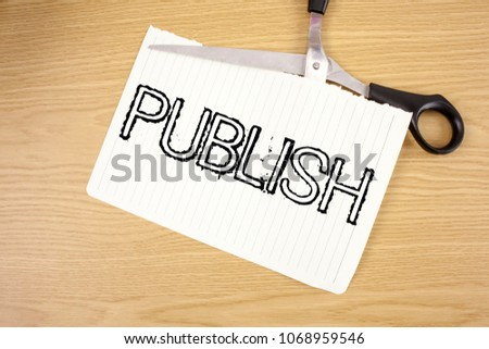 Conceptual hand writing showing Publish. Business photo text Make information available to people Issue a written product written on Tear Notebook Paper on wooden background Scissor. #1068959546