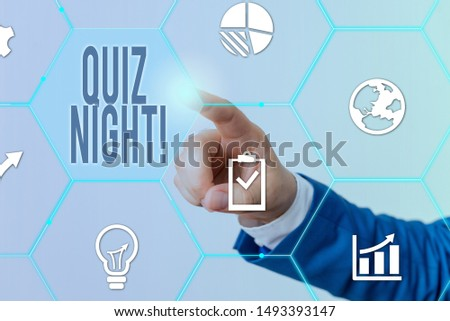 Conceptual hand writing showing Quiz Night. Business photo showcasing evening test knowledge competition between individuals Male human wear formal suit presenting using smart device.
