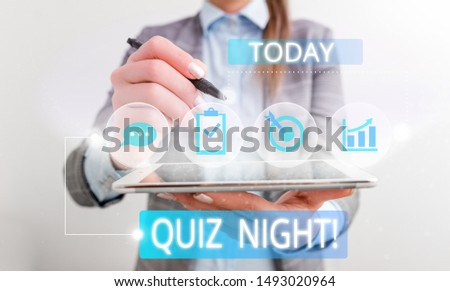 Conceptual hand writing showing Quiz Night. Business photo text evening test knowledge competition between individuals Female human wear formal work suit presenting smart device.