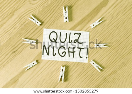 Conceptual hand writing showing Quiz Night. Business photo text evening test knowledge competition between individuals Colored crumpled papers wooden floor background clothespin.