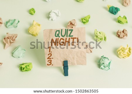Conceptual hand writing showing Quiz Night. Business photo text evening test knowledge competition between individuals Colored crumpled paper empty reminder white floor clothespin.