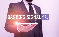 Conceptual hand writing showing Ranking Signal. Business photo showcasing characteristic of a website that search engine algorithms Male human wear formal work suit hold smartphone using hand.