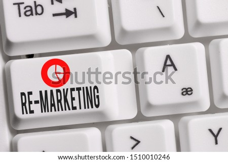 Conceptual hand writing showing Re Marketing. Business photo showcasing Strategy to reach potential customers in your website Keyboard with note paper on white background key copy space.