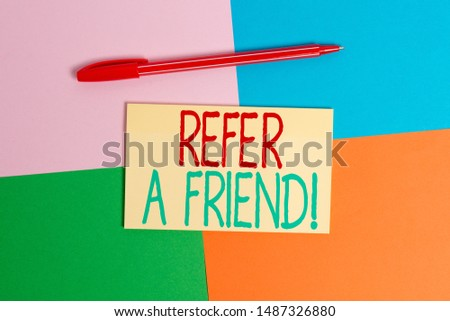 Conceptual hand writing showing Refer A Friend. Business photo text direct someone to another or send him something like gift Office appliance square desk study supplies paper sticker.