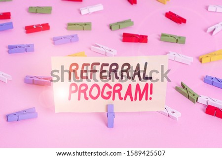 Conceptual hand writing showing Referral Program. Business photo showcasing internal recruitment method employed by organizations Colored clothespin papers empty reminder pink floor office.