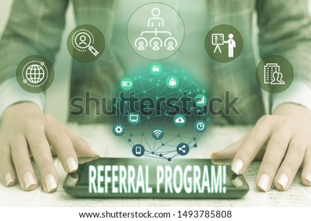 Conceptual hand writing showing Referral Program. Business photo text internal recruitment method employed by organizations Female human wear formal work suit presenting smart device. #1493785808