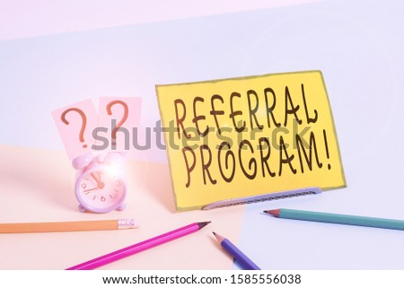 Conceptual hand writing showing Referral Program. Business photo text internal recruitment method employed by organizations Mini size alarm clock beside stationary on pastel backdrop.