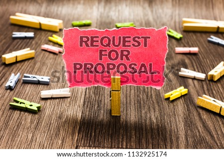 Conceptual hand writing showing Request For Proposal. Business photo text document contains bidding process by agency or company Clips spread woody table learn study things class schooling. #1132925174