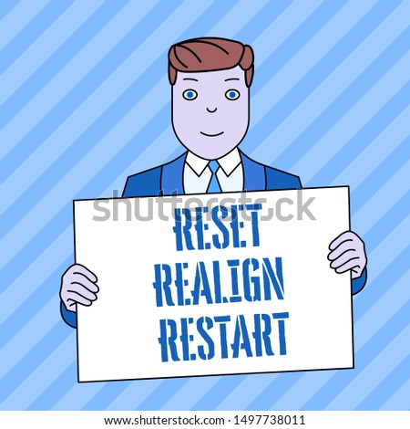 Conceptual hand writing showing Reset Realign Restart. Business photo showcasing Life audit will help you put things in perspectives Smiling Man Holding Suit Poster Board in Front of Himself.