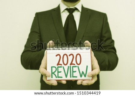 Conceptual hand writing showing 2020 Review. Business photo showcasing seeing important events or actions that made previous year. #1510344419