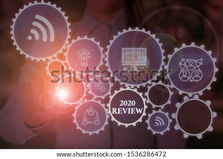 Conceptual hand writing showing 2020 Review. Business photo showcasing seeing important events or actions that made previous year Woman wear work suit presenting presentation smart device. #1536286472