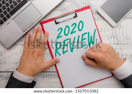 Conceptual hand writing showing 2020 Review. Business photo text seeing important events or actions that made previous year. #1507015082