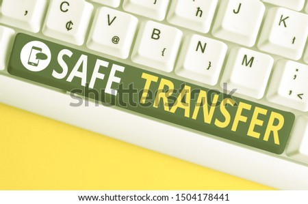Conceptual hand writing showing Safe Transfer. Business photo text Wire Transfers electronically Not paper based Transaction White pc keyboard with note paper above the white background. #1504178441