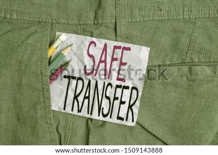 Conceptual hand writing showing Safe Transfer. Business photo text Wire Transfers electronically Not paper based Transaction Writing equipment and purple note paper inside pocket of trousers. #1509143888