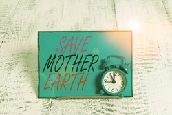 Conceptual hand writing showing Save Mother Earth. Business photo showcasing doing small actions prevent wasting water heat energy Alarm clock tilted above buffer wire in front of notepaper.