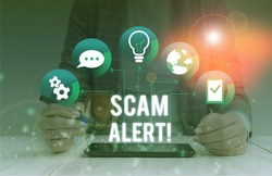 Conceptual hand writing showing Scam Alert. Business photo showcasing fraudulently obtain money from victim by persuading him Female human wear formal work suit presenting smart device.