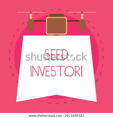 Conceptual hand writing showing Seed Investor. Business photo text source of initial money required to start a new business Unique design of night lampshade with two air blowers on the top.