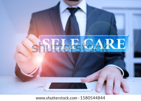 Conceptual hand writing showing Self Care. Business photo text practice of taking action preserve or improve ones own health Male human wear formal clothes present use hitech smartphone.