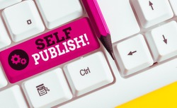 Conceptual hand writing showing Self Publish. Business photo showcasing writer publish piece of ones work independently at own expense White pc keyboard with note paper above the white background.