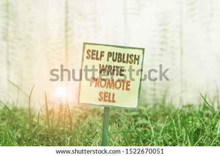 Conceptual hand writing showing Self Publish Write Promote Sell. Business photo showcasing Auto promotion writing Marketing Publicity Plain paper attached to stick and placed in the grassy land.