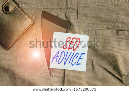 Conceptual hand writing showing Seo Advice. Business photo text guidance or recommendations in enhancing the search engine Smartphone device inside trousers front pocket with wallet.