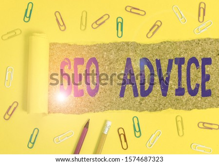 Conceptual hand writing showing Seo Advice. Business photo text guidance or recommendations in enhancing the search engine Stationary and torn cardboard on a wooden classic table backdrop.