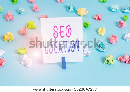Conceptual hand writing showing Seo Location. Business photo showcasing process to optimize pages on your site to show for organic Colored crumpled papers empty reminder blue floor clothespin.
