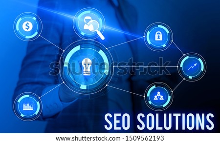 Conceptual hand writing showing Seo Solutions. Business photo showcasing Search Engine Result Page Increase Visitors by Rankings Woman wear work suit presenting presentation smart device. #1509562193