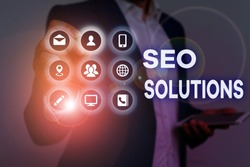 Conceptual hand writing showing Seo Solutions. Business photo text Search Engine Result Page Increase Visitors by Rankings.