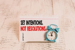 Conceptual hand writing showing Set Intentions Not Resolutions. Business photo text Positive choices for new start achieve goals.