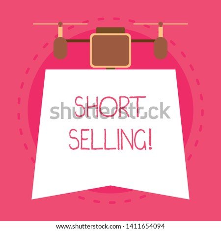 Conceptual hand writing showing Short Selling. Business photo text Act of selling an asset that you do not currently own Unique design of night lampshade with two air blowers on the top.
