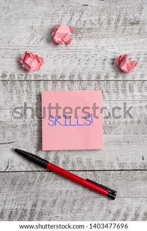 Conceptual hand writing showing Skills. Business photo showcasing ability do something very well by nature Stationary and paper scraps with sheets on the wooden desk. #1403477696