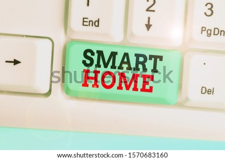 Conceptual hand writing showing Smart Home. Business photo showcasing automation system control lighting climate entertainment systems. #1570683160