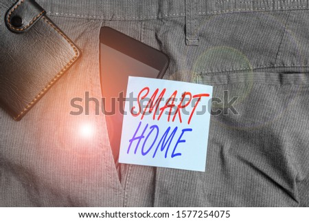 Conceptual hand writing showing Smart Home. Business photo text automation system control lighting climate entertainment systems Smartphone device inside trousers front pocket with wallet. #1577254075