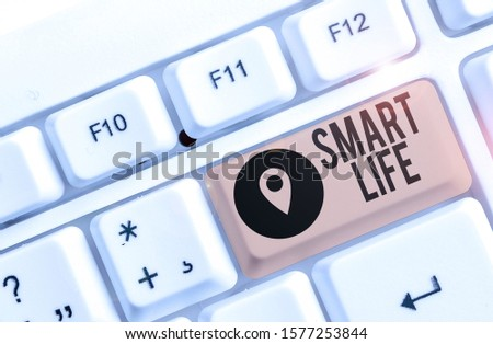 Conceptual hand writing showing Smart Life. Business photo showcasing approach conceptualized from a frame of prevention and lifestyles White pc keyboard with note paper above the white background.