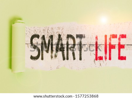 Conceptual hand writing showing Smart Life. Business photo showcasing approach conceptualized from a frame of prevention and lifestyles Cardboard which is torn placed above a wooden classic table.