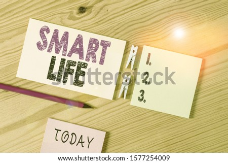 Conceptual hand writing showing Smart Life. Business photo text approach conceptualized from a frame of prevention and lifestyles Colored crumpled papers wooden floor background clothespin.