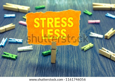 Conceptual hand writing showing Stress Less. Business photo text Stay away from problems Go out Unwind Meditate Indulge Oneself Clothespin holding orange paper note clothespins wooden floor.