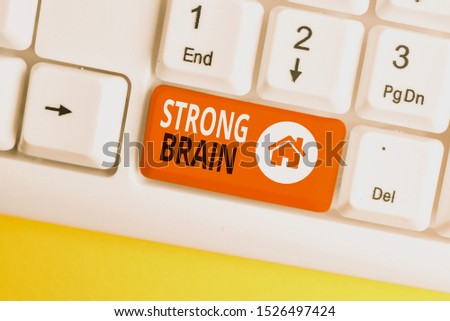 Conceptual hand writing showing Strong Brain. Business photo showcasing own firm attitudes and opinions and are not easily influenced White pc keyboard with note paper above the white background.