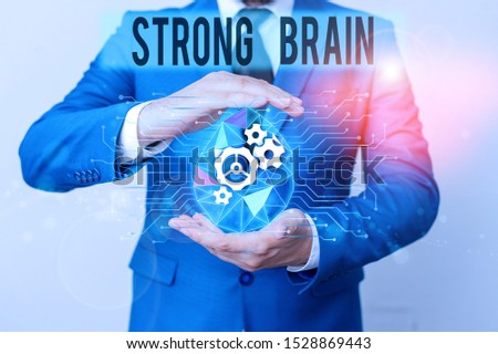 Conceptual hand writing showing Strong Brain. Business photo showcasing own firm attitudes and opinions and are not easily influenced Male human wear formal suit presenting using smart device.