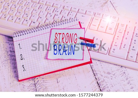 Conceptual hand writing showing Strong Brain. Business photo showcasing own firm attitudes and opinions and are not easily influenced notebook reminder clothespin with pinned sheet light wooden.