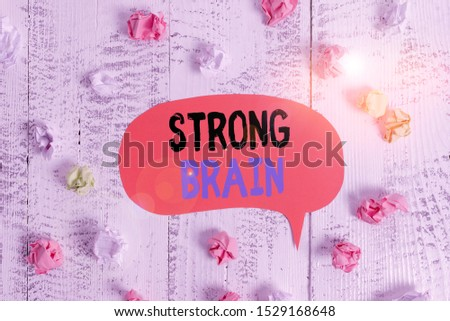 Conceptual hand writing showing Strong Brain. Business photo text own firm attitudes and opinions and are not easily influenced Colored speech bubble paper balls wooden rustic vintage background.