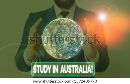 Conceptual hand writing showing Study In Australia. Business photo showcasing going into foreign country order complete your studies Elements of this image furnished by NASA.