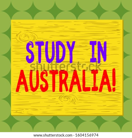 Conceptual hand writing showing Study In Australia. Business photo showcasing going into foreign country order complete your studies Square rectangle unreal cartoon wood on the coloured wall.