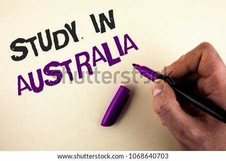Conceptual hand writing showing Study In Australia. Business photo showcasing Graduate from oversea universities great opportunity written by Man on plain background holding Marker in Hand.