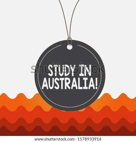 Conceptual hand writing showing Study In Australia. Business photo text going into foreign country order complete your studies Label string round empty tag colorful background small shape.