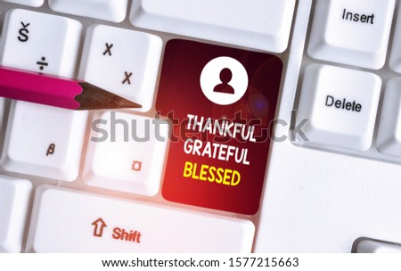 Conceptual hand writing showing Thankful Grateful Blessed. Business photo showcasing Appreciation gratitude good mood attitude White pc keyboard with note paper above the white background.