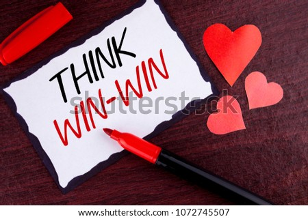 Conceptual hand writing showing Think Win-Win. Business photo text Negotiation strategy for both partners to obtain benefits written Sticky Note Paper wooden background Marker and Hearts #1072745507